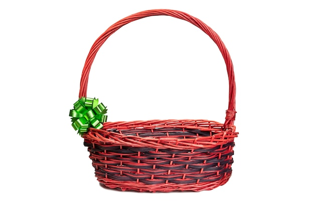 Red basket with green ribbon on white background