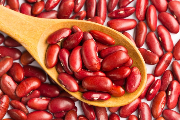 Red beans background with wooden spoon