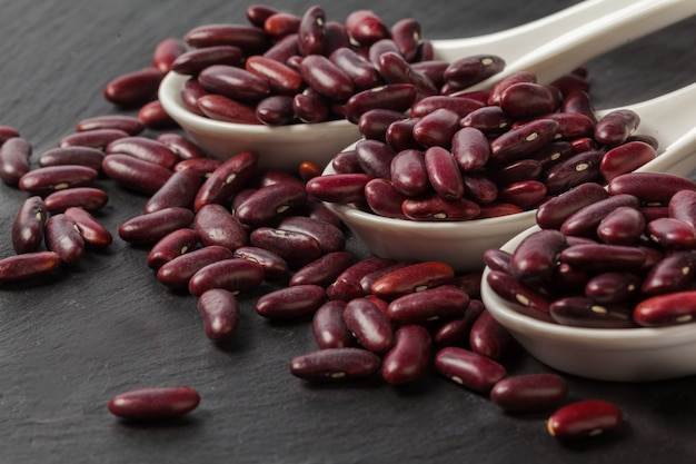 Red beans on the black table