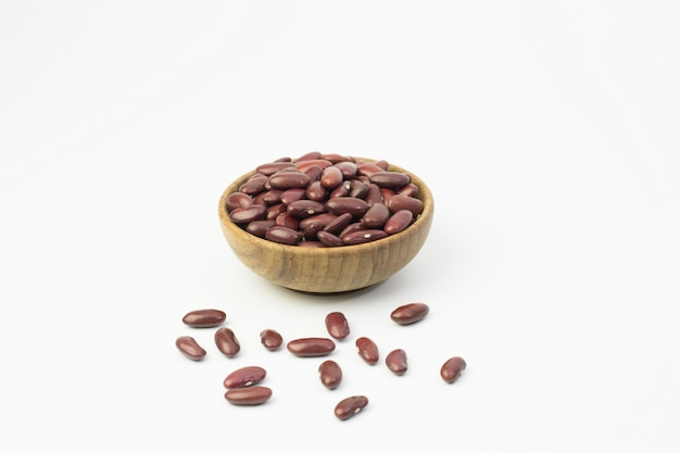 Red beans in brown wooden bowl isolated on white background