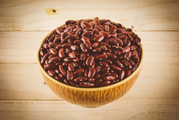 Red  beans on wood background - soft focus with vintage film filter