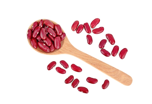 Red beans on wooden spoon isolated white background
