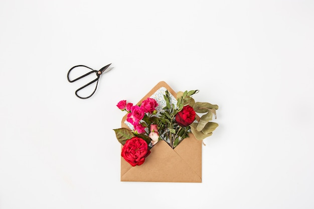 Red beautiful roses in envelope