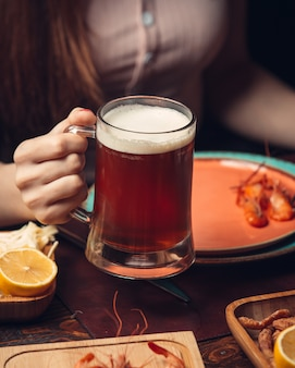 Red beer mug with shrimps and lemon