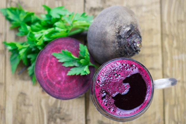 Red beets and beet juice in a glass mug