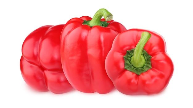クリッピングパスで白い表面に分離された赤ピーマン。 3つの丸ごと野菜。