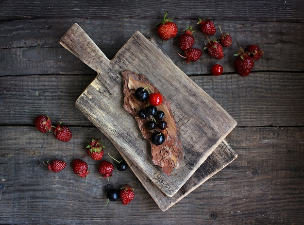Red berry strawberry, wooden rustic background. organic natural products.