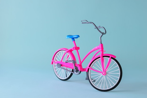 Red bike with blue saddle on light blue background. bicycle for trips around the city and region.