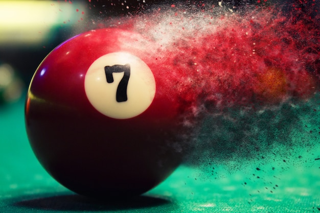 Red billiard ball splits into particles and debris