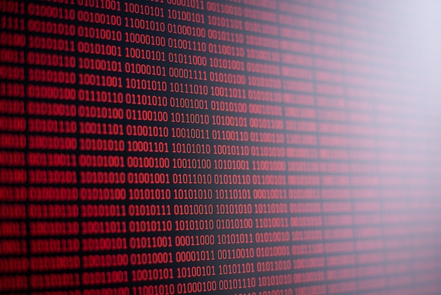 Red binary code on computer screen. information, data, science, computer technology