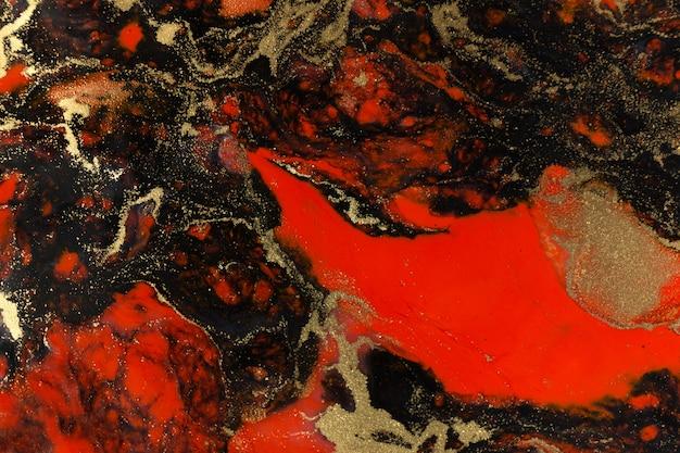 赤、黒、ゴールドの液体の背景をペイントします。抽象的な大理石のテクスチャです。