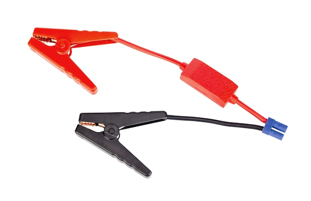 Red and black car battery jumper cable for charger or booster isolated on white background.