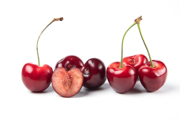 Red and black cherries on white background