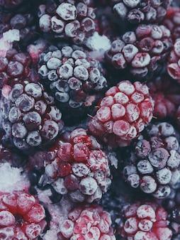Red and black frozen raspberries.
