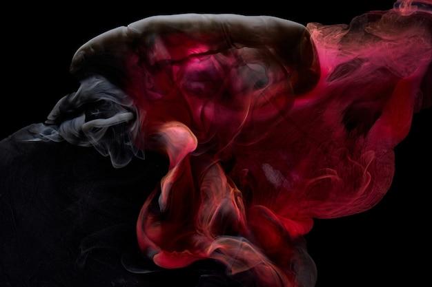 Красный черный пигмент циркулирующие чернила абстрактный фон, жидкая дымовая краска под водой