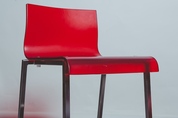 Red and black plastic chair close up