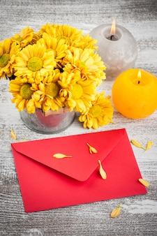 Red blank envelope and golden chrysanthemum