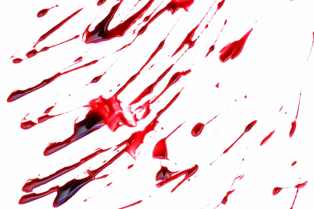 Red blood splattered on a white surface