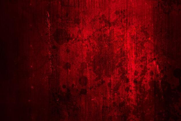 Красный кровавый грязный гранж для ужаса на месте преступления страшная стена для фона.