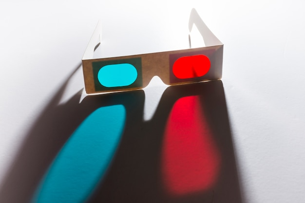 Red and blue 3d glasses on reflective white background