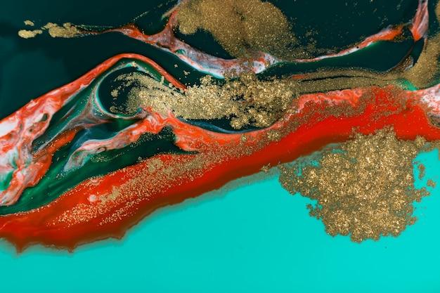 赤、青、金の抽象的なペイントの大理石の背景。