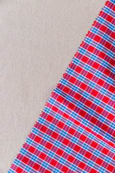 Red and blue chequered pattern fabric on plain textile