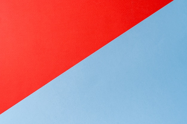 Red and blue colors abstract paper background with geometric shape, flat lay.