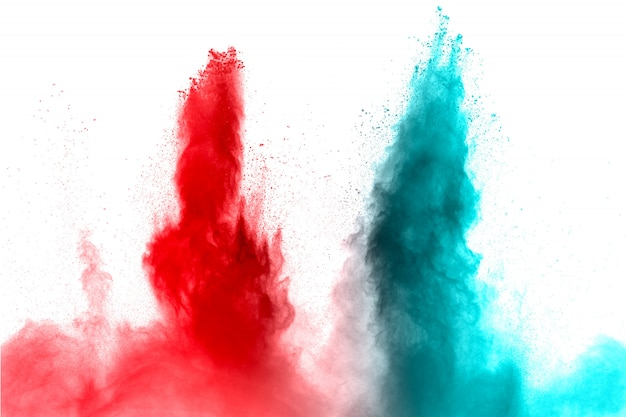 Red and blue powder explosion on white background.