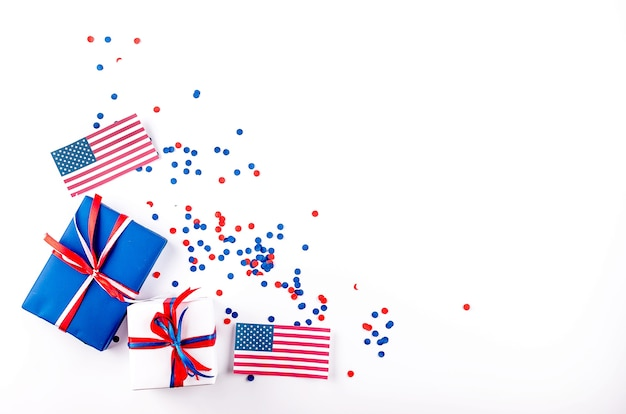 Red, blue and white gift boxes on a white background, colors of america,