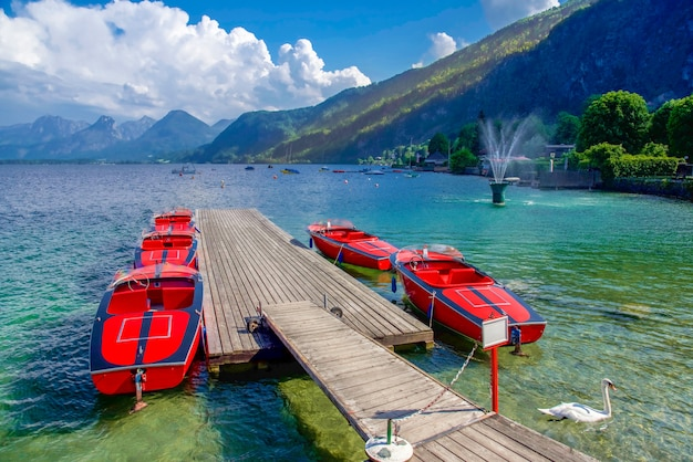 Red boats in lake in austria, europe