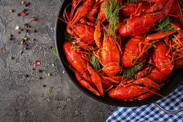 Red boiled craw fishes on table in rustic style