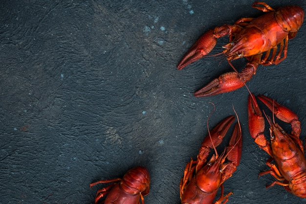 Red boiled crawfishes on table in rustic style