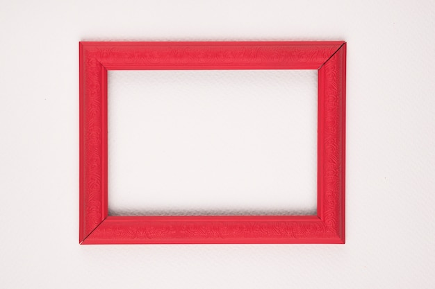 Red border wooden frame on white background