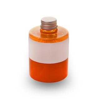 白い表面に液体石鹸の赤いボトルと蓋を閉めた