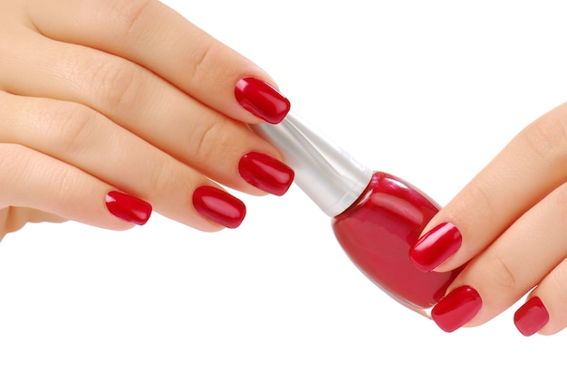 Red bottlel of nail polish