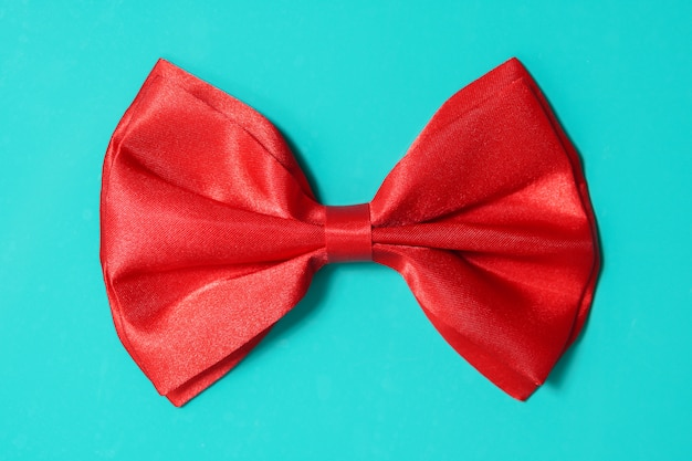 Red bow ite on green background