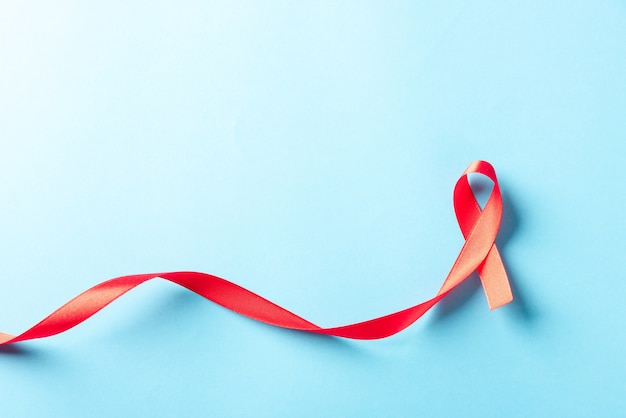 Red bow ribbon symbol hiv, aids cancer awareness with shadows