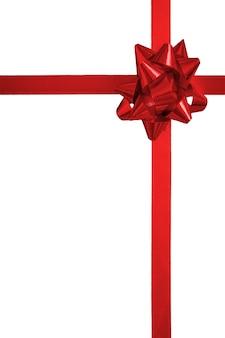 白い背景で隔離のリボンと赤い弓
