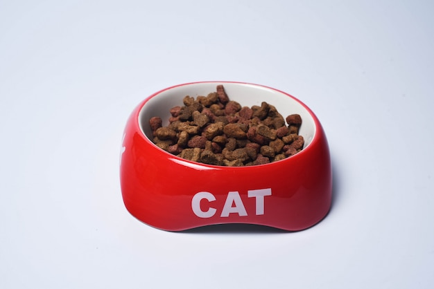 Red bowl with cat's food