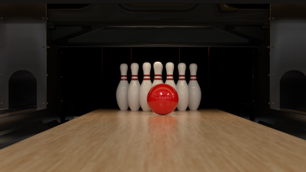 Красный шар для боулинга на деревянной дорожке с кеглями