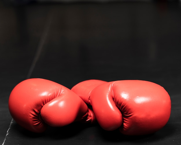 Red boxing gloves close-up