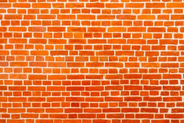 赤レンガの建物の壁。モダンなロフトのインテリア。デザインとインタビューの録音の背景。