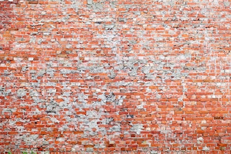 Red brick dirty background.