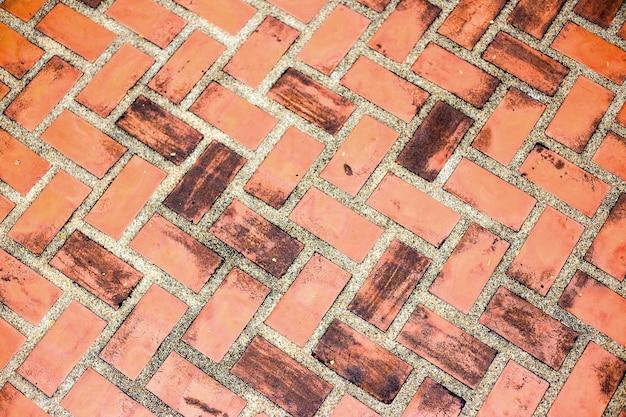Текстура образца пола красного кирпича для фона