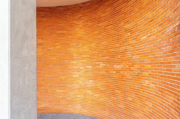 Red brick pattern on wall in curve on building. abstract background. architecture backdrop.