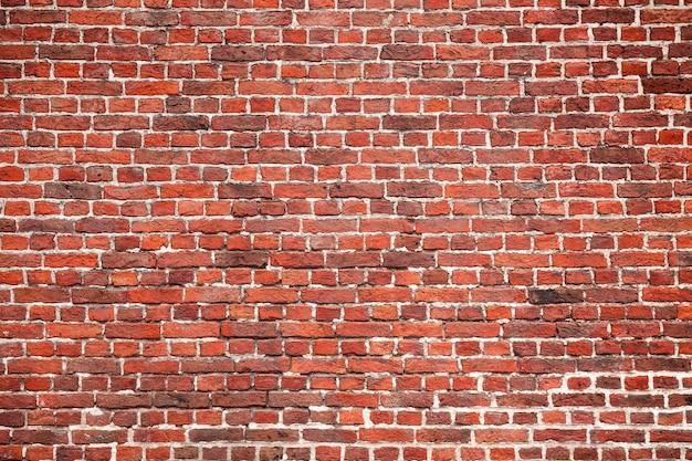 Красный кирпич стены фон