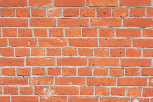 赤レンガの壁の近い視点。赤毛の背景の垂直写真を閉じる