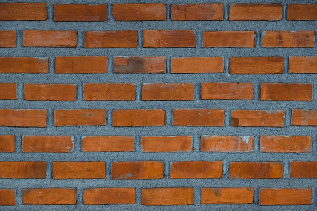 Red brick wall fragment background or brick layer building texture.