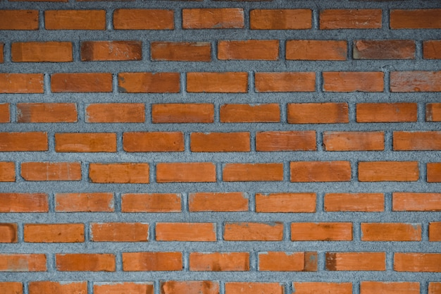 Red brick wall fragment background or brick layer building