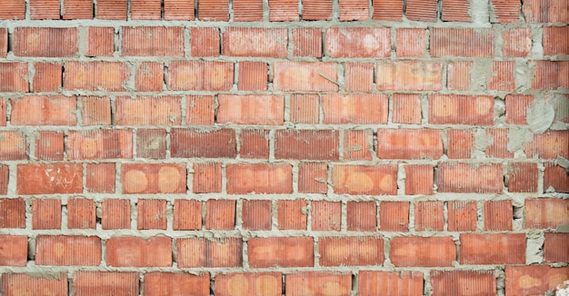 Red brick wall rough in construction texture for background